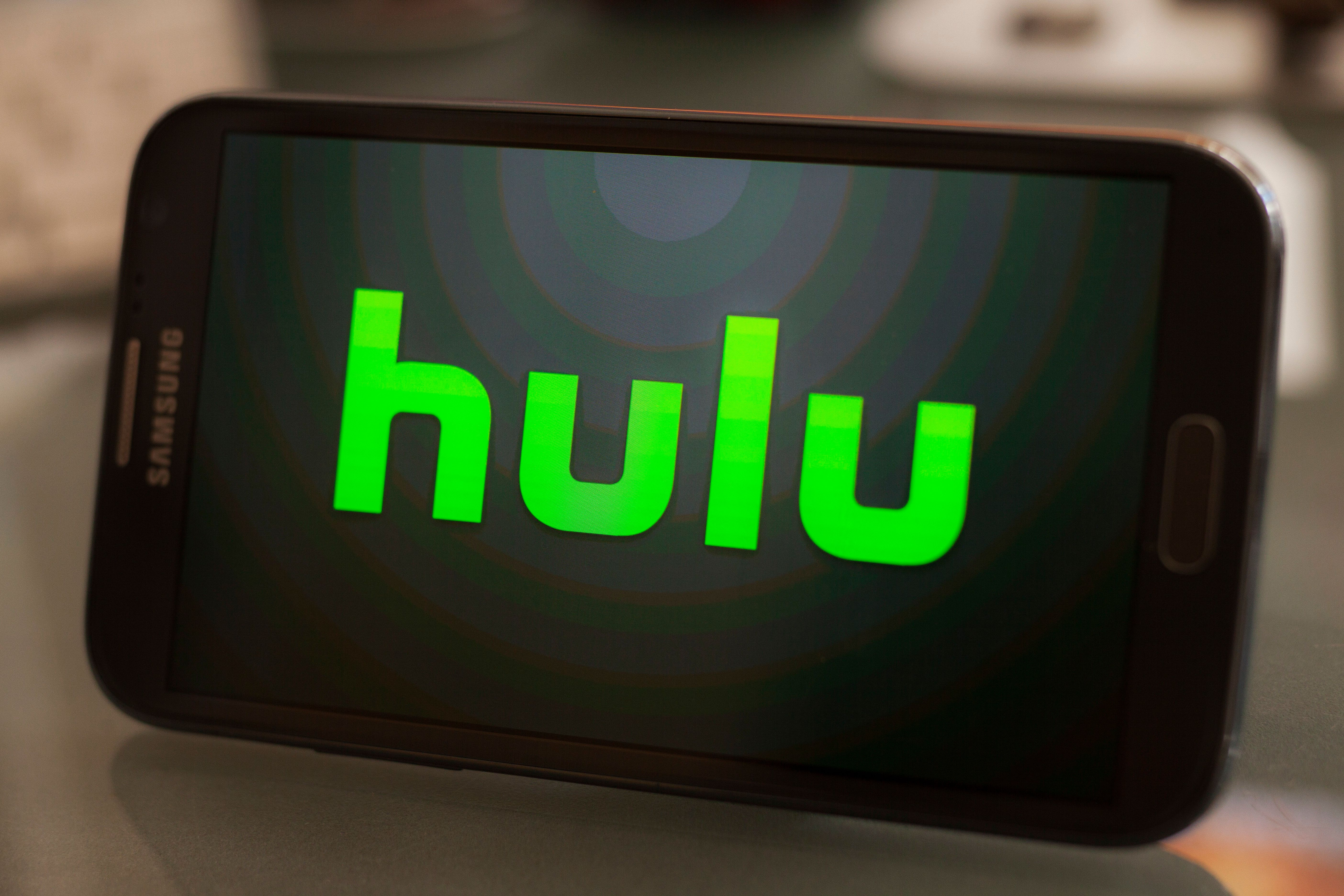Hulu logo on a smartphone. Hulu is an on-demand media streaming company. (Photo by Ted Soqui/Corbis via Getty Images)