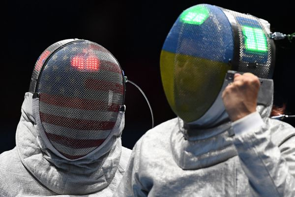 Ukraine's Olena Kravatska (R) reacts as she competes against Ibtihaj Muhammad of the U.S. during their women's individual sab