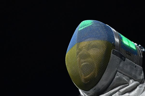 Ukraine's Olena Kravatska reacts as she competes against Ibtihaj Muhammad of the U.S. during their women's individual sabre q