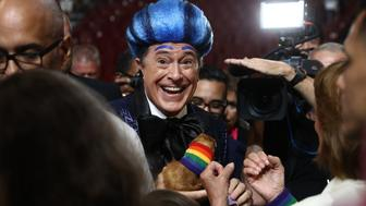 Television personality Stephen Colbert smiles while performing on the floor of the Wells Fargo Center ahead of the Democratic National Convention (DNC) in Philadelphia, Pennsylvania, U.S., on Sunday, July 24, 2016. A heat wave has settled over the City of Brotherly Love as tens of thousands of delegates converge on the city for the Democratic National Convention. Photographer: Andrew Harrer/Bloomberg via Getty Images