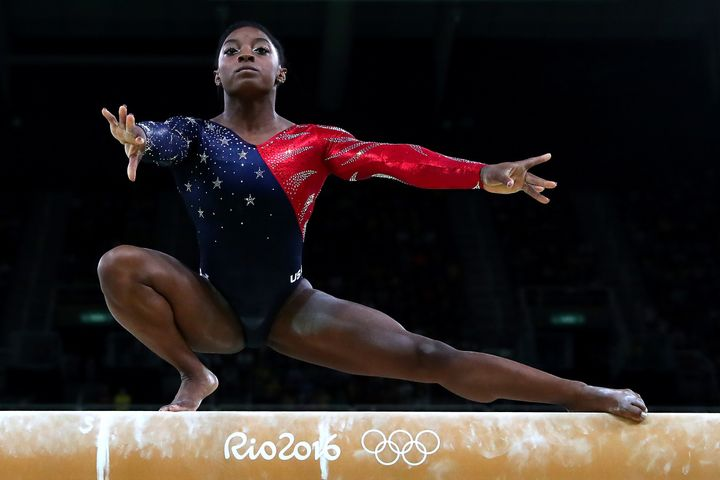 Simone Biles competes on the balance beam during women's qualification for artistic gymnastics on Day 2 of the Rio 2016 Olymp