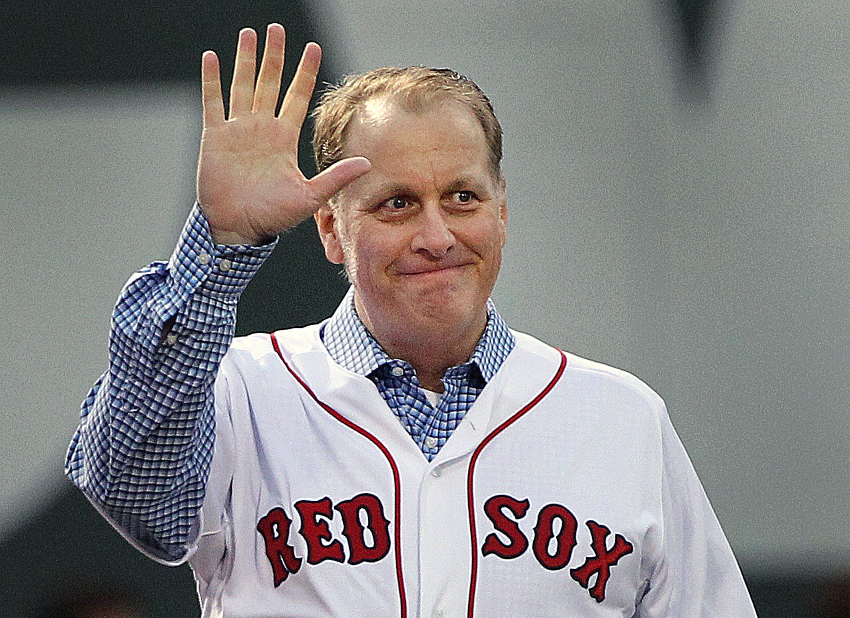 BOSTON - MAY 28: Before the game, the Red Sox honored the tenth anniversary of the 2004 World Series Championship team. Pitcher Curt Schilling, who is battling cancer acknowledges the cheers of the crowd as he walks in from left field. The Boston Red Sox hosted the Atlanta Braves in an interleague MLB game at Fenway Park. (Photo by Jim Davis/The Boston Globe via Getty Images)