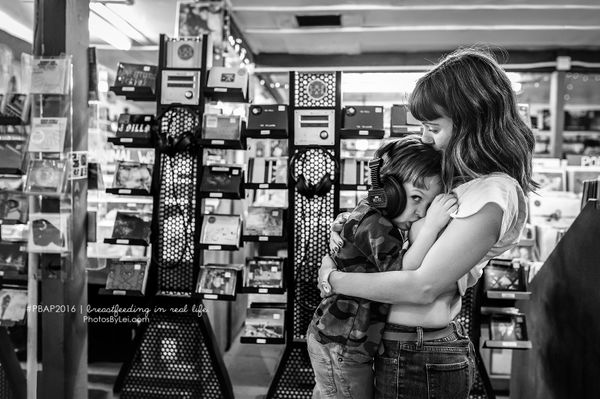 A public nursing session in a record store in Austin, TX by breastfeeding photographer Leilani Rogers.