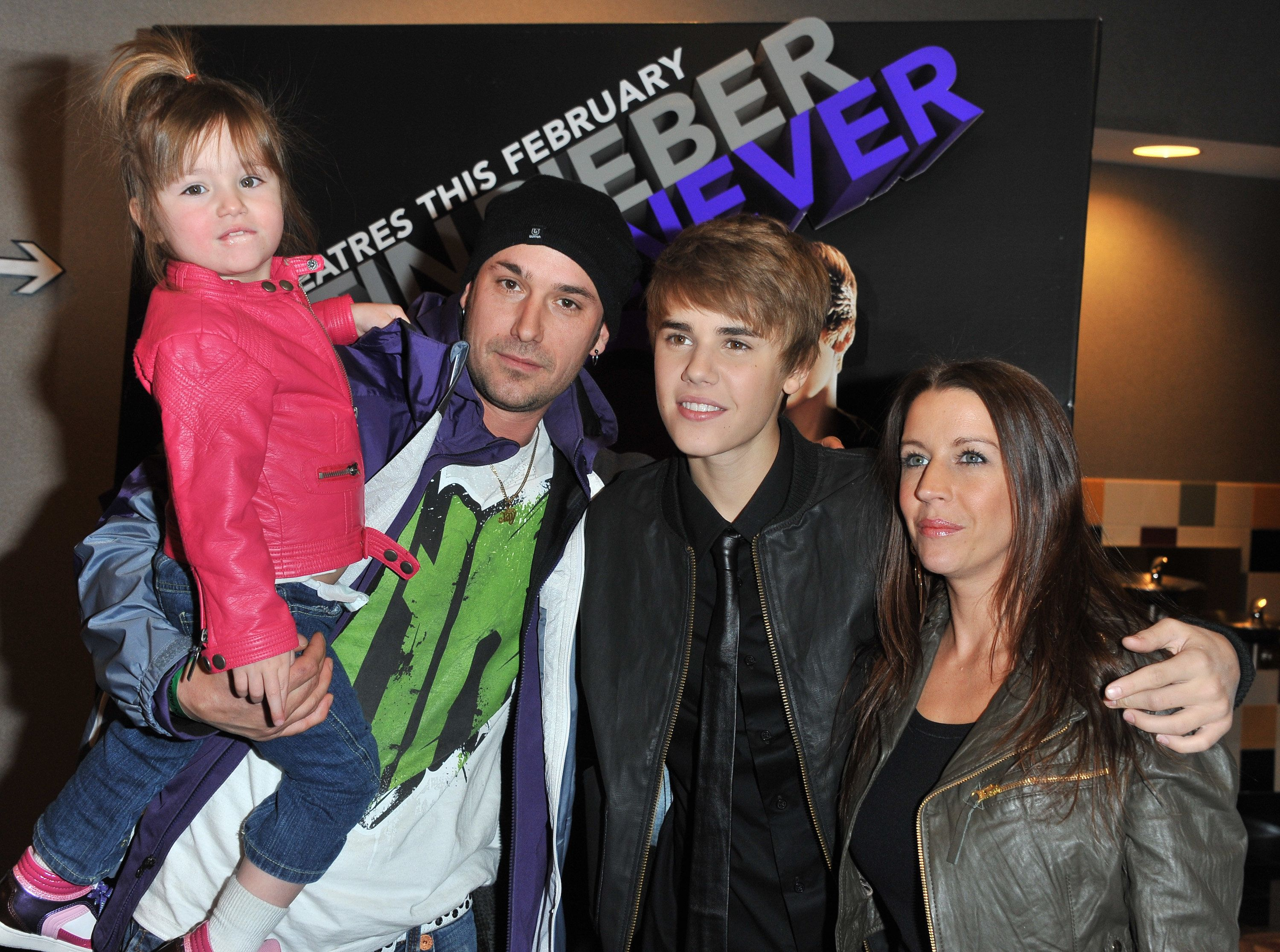 TORONTO, ON - FEBRUARY 01:  (L-R) Sister Jazmyn Bieber, father Jeremy Bieber, singer Justin Bieber and mother Pattie Lynn Mallete attend the premiere for 'Never Say Never' at the AMC Yonge & Dundas 24 theater on February 1, 2011 in Toronto, Canada.  (Photo by George Pimentel/WireImage)
