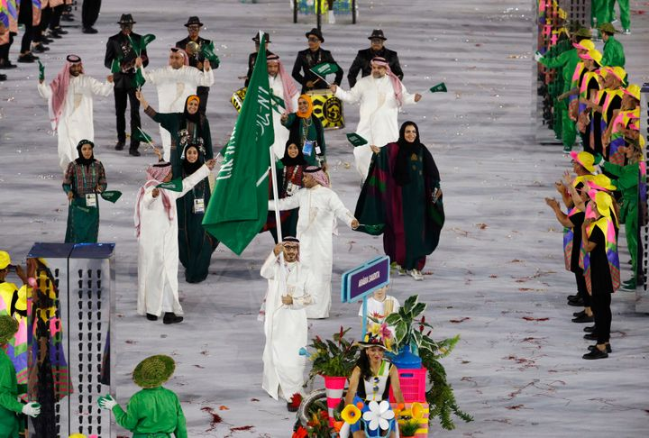 Flagbearer Sulaiman Hamad (KSA) of Saudi Arabia leads his contingent during the opening ceremony.