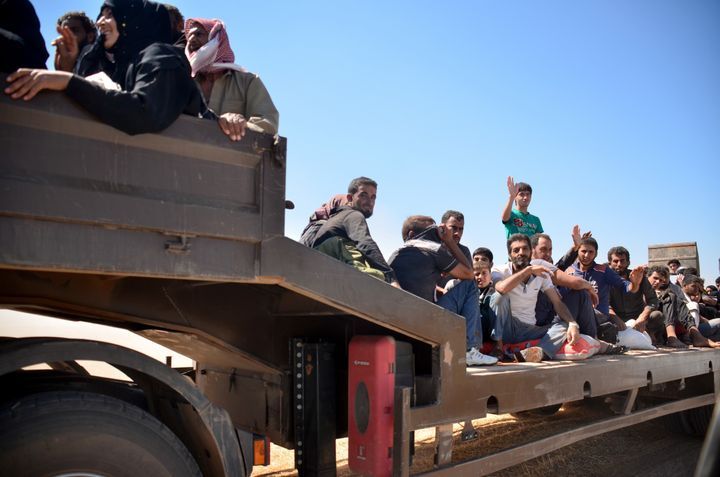 Civilians flee from ISIS-controlled territoriesdue to clashes in Aleppo, Syria on July 4, 2016.