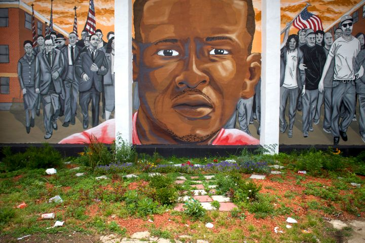 "A mural in Baltimore depicts Freddie Gray, who died in custody of Baltimore Police officers following a ""rough ride"" in"