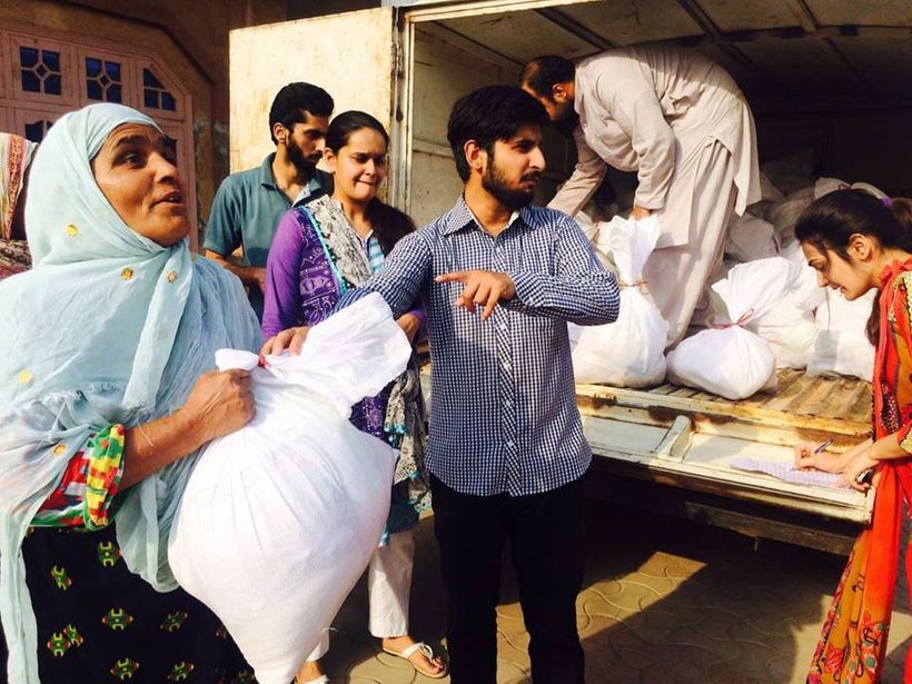 Wheat and rice bags being distributed in Lahore, Pakistan