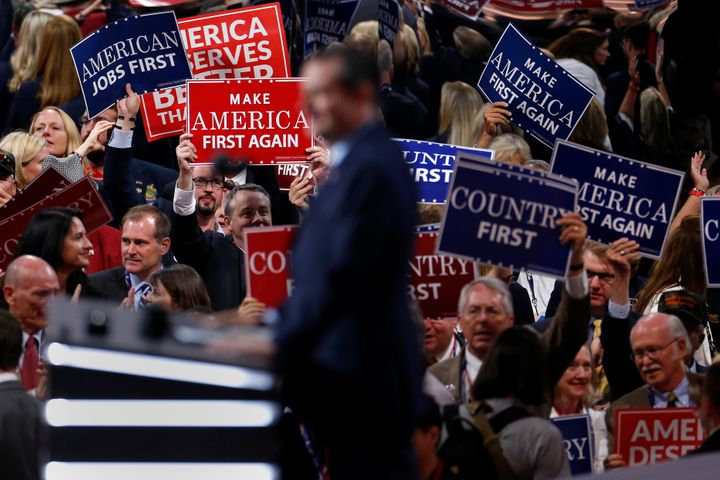 People wave placards during senator Ted Cruz's speech at the Republican National Convention in Cleveland.