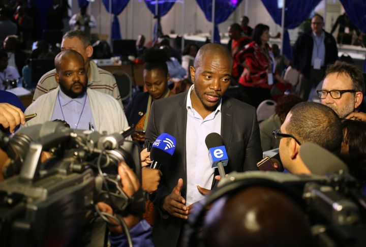 Democratic Alliance leader Mmusi Maimane gestures as he speaks to members of the media at the result center in Pretoria, Sout