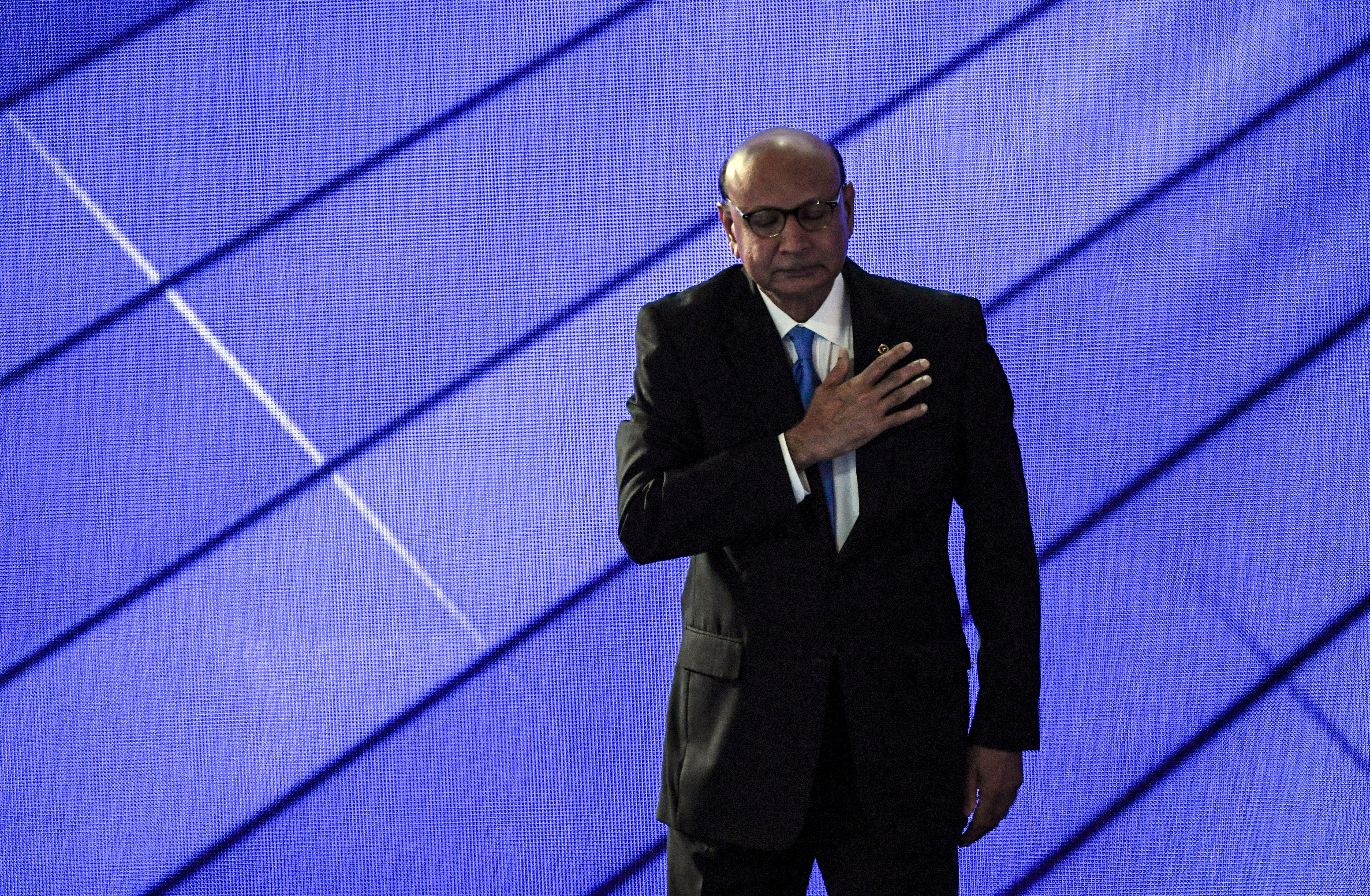 PHILADELPHIA, PA - JULY 28: Khzir Khan, the father of fallen soldier Humayun Kahn, pauses before leaving the stage after addressing the crowd during the final day of the Democratic National Convention in Philadelphia on Thursday, July 28, 2016. (Photo by Toni L. Sandys/The Washington Post via Getty Images)