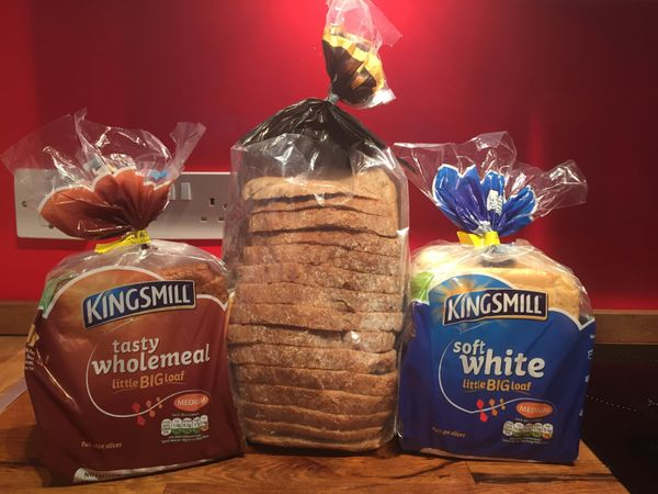 Here's how Kingsmill's tiny loaves compare in size to another brand of bread, Tesco's Finest Marbled Rye Cob.