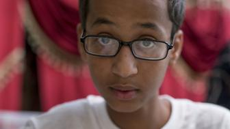 IRVING, TX - SEPTEMBER 17: Ahmed Mohamed, a Texas Muslim teen arrested after taking his homemade clock to school, explains his clock at his house in Irving, Texas on September 17, 2015. A Texas Muslim teen arrested after taking his homemade clock to school, on Wednesday accepted an invitation by President Barack Obama to show off his invention at the White House. (Photo by Bilgin S. Sasmaz/Anadolu Agency/Getty Images)