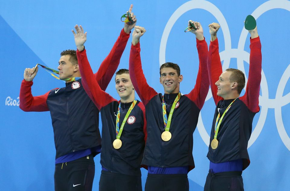 RIO DE JANEIRO, BRAZIL - AUGUST 7: Gold medalists Nathan Adrian, Ryan Held, Michael Phelps and Caeleb Dressell of USA pose du