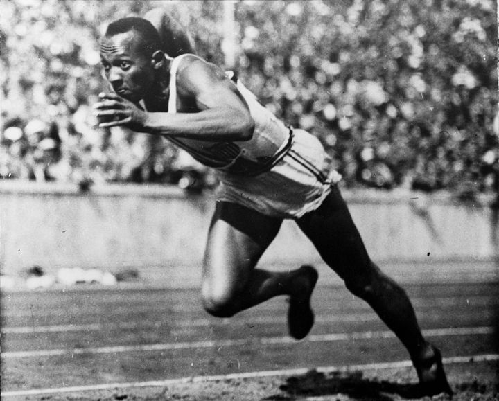 In this 1936 file photo, Jesse Owens of the United States runs in a 200-meter preliminary heat at the 1936 Summer Olympics in