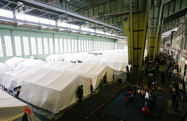 A general view of tents at a shelter for migrants inside a hangar of another centre at the former Tempelhof...
