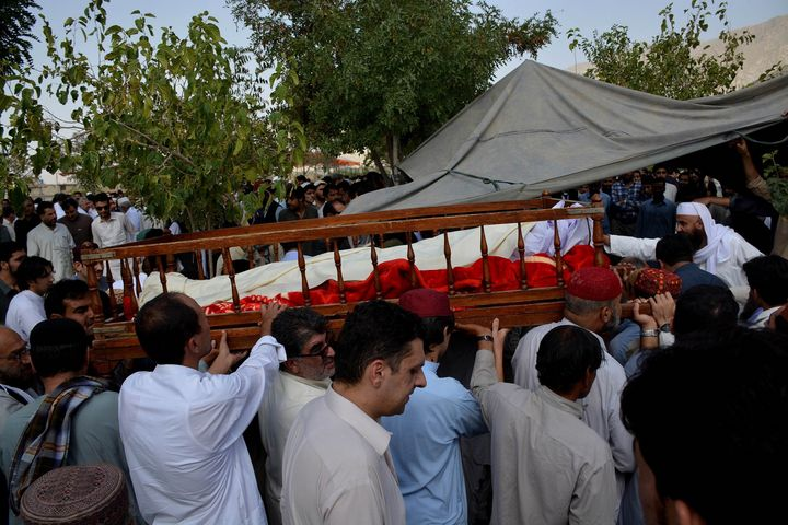 Relatives of suicide attack victims carry coffins during a funeral ceremony in Quetta, the provincial capital of Balochistan,