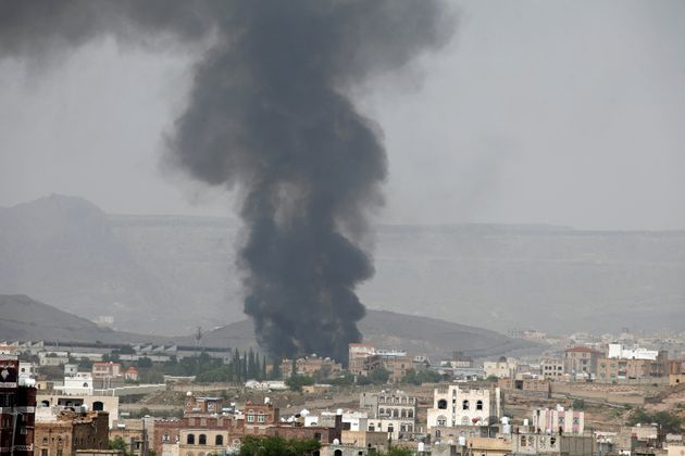 Smoke rises from a snack food factory after a Saudi-led air strike hit it in Sanaa, Yemen, on