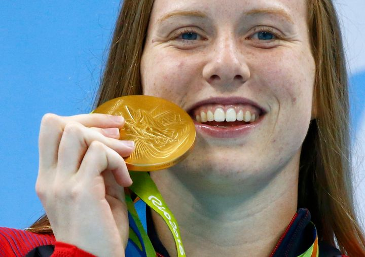 Lilly King celebrates her gold medal victory.