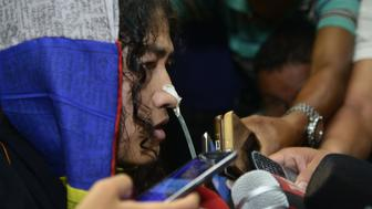 Indian rights activist Irom Sharmila talks to media after appearing before a District and Sessions Judge at Imphal West court in Imphal on August 9, 2016. An Indian rights activist who has waged what is thought to be the world's longest hunger strike ended her 16-year fast on August 9 after vowing to continue her struggle by standing for election in her home state. Irom Sharmila, dubbed the 'Iron Lady of Manipur' for her unwavering protest against alleged rights abuses by security forces in the insurgency-hit northeast Indian state, was released on bail after she promised a court she would end her fast.  / AFP / Biju BORO        (Photo credit should read BIJU BORO/AFP/Getty Images)