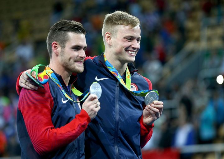 Silver medalists David Boudia (L) & Steele Johnson (R) of USA pose with their Olympic medals, Aug. 8, 2016.