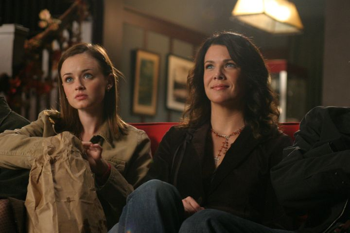 Medium shot of Alexis Bledel as Rory sitting on couch with Lauren Graham as Lorelai.