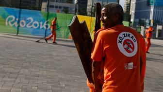"REFILE BYLINE CORRECTION 2016 Rio Olympics - Olympic Park - Rio de Janeiro, Brazil - 31/07/2016. A workers wears a sign which reads ""Shoo Zika!"" in Portuguese on his back in the Olympic park.         REUTERS/Pilar Olivares FOR EDITORIAL USE ONLY. NOT FOR SALE FOR MARKETING OR ADVERTISING CAMPAIGNS."