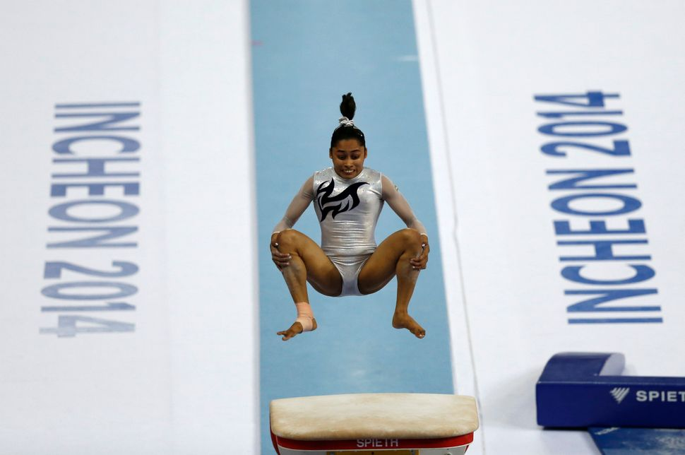 Dipa Karmakar competes in the women's vault final of the artistic gymnastics competition during the 17th Asian Games in