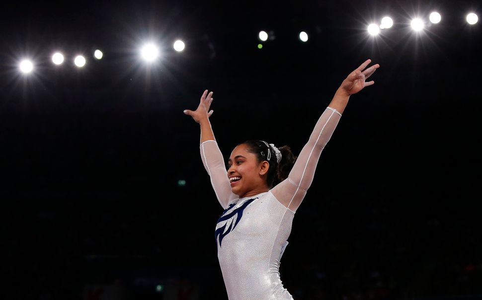 Dipa Karmakar reacts after a successful vault during the women's gymnastics vault apparatus final at the 2014 Commonwea