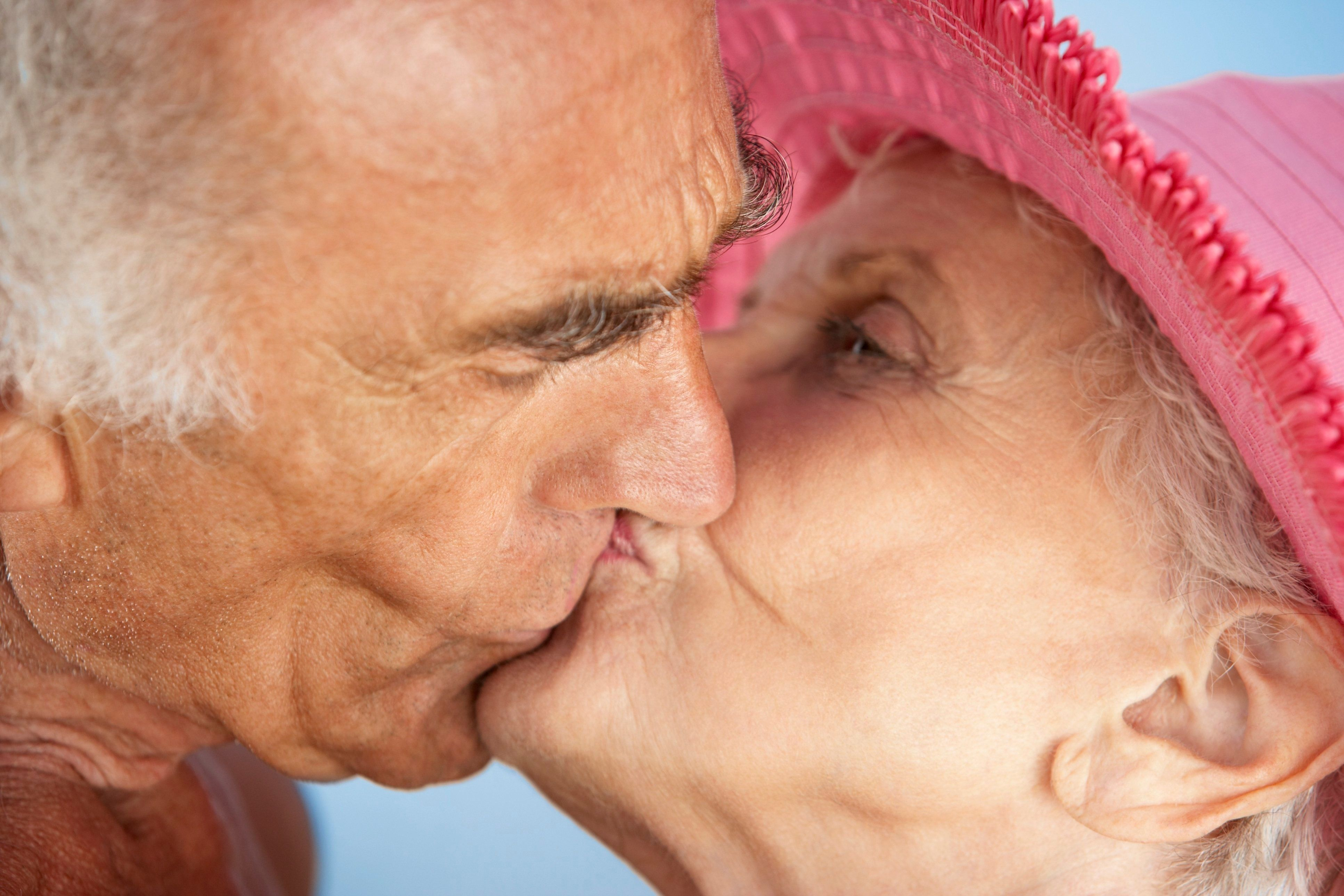 Close up of senior couple kissing