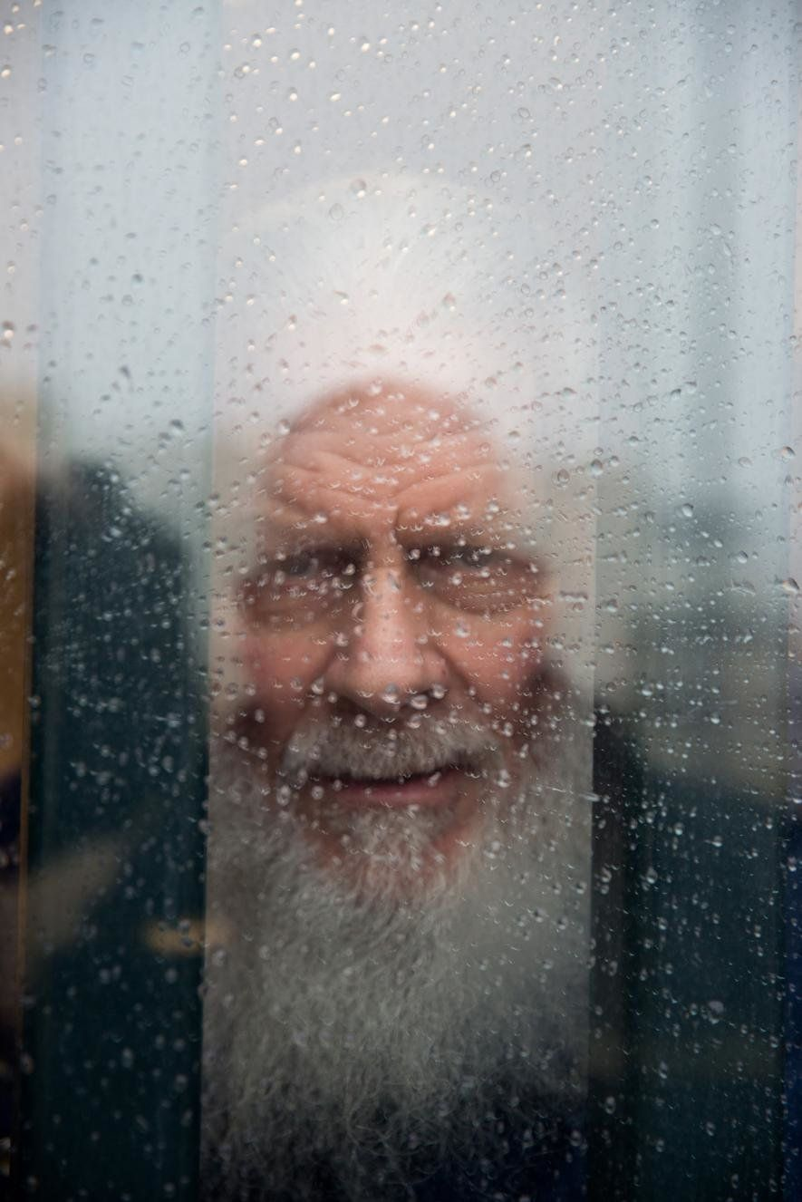 Robert, 70, looks out his cell window. He has spent nearly 30 years in prison after being convicted of murder. In his free ti