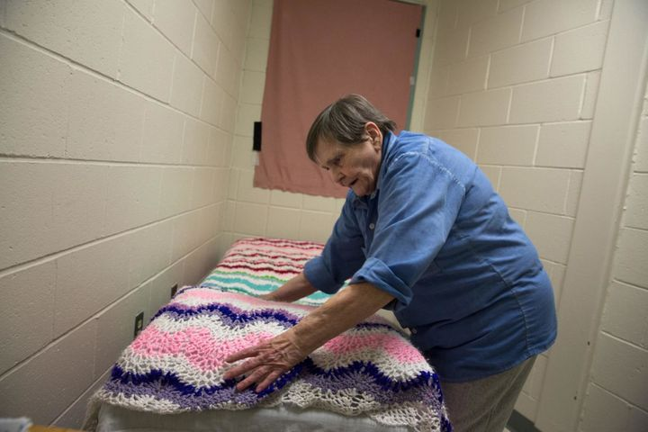 At Maine Correctional Center, Norma, 76, makes her bed in what used to be a closet. Norma requested that she be separated fro