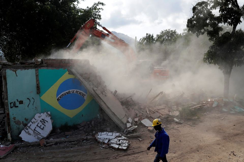 One of the last remaining homes in Vila Autódromo, a favela near Rio's Olympic Village, is demolished...