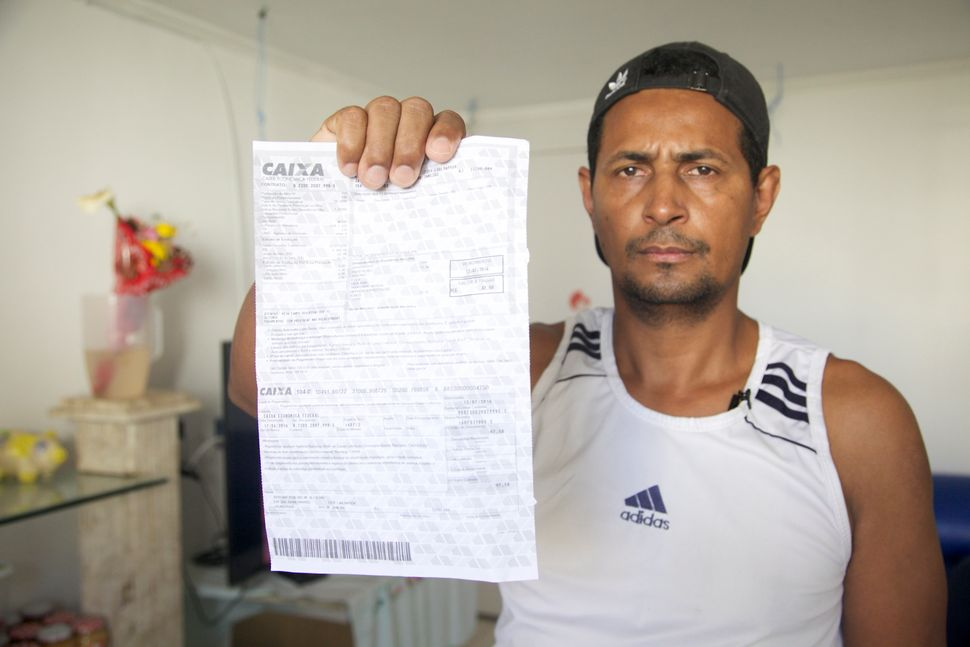 "Iran Souza was relocated to new housing after his home in Autódromo was demolished, but he's not happy. ""Most fam"