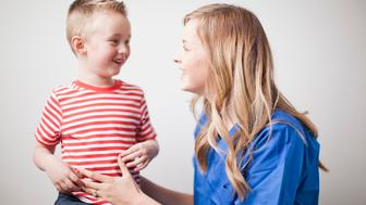 Mother talking to toddler boy (2-3)