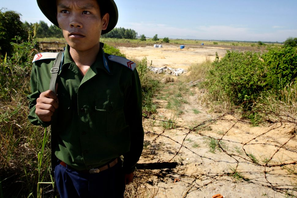 A Vietnamese soldier guards the contaminated site at the edge of the Da Nang Airfield on July 1, 2009 in Da Nang, Central Vie