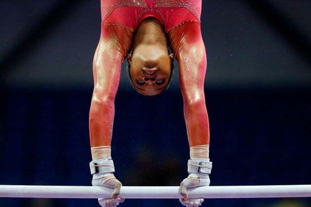 Gabby Douglas warms up on the uneven bars during the U.S. women's gymnastics championships, inJune...