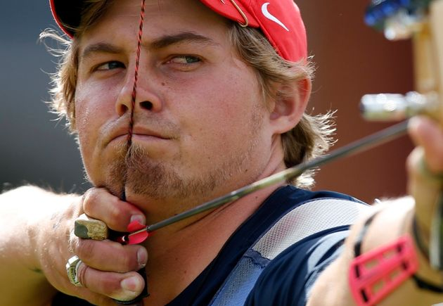 Brady Ellison of the U.S. takes aim during the men's archery team quarterfinals at the Lords Cricket...