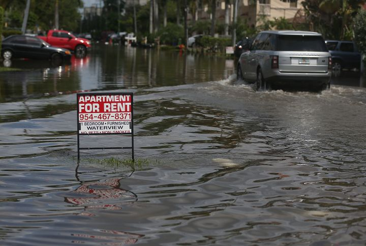 An apartment for rent sign is seen in a flooded Fort Lauderdale, Florida, street in September 2015. The conditions were cause