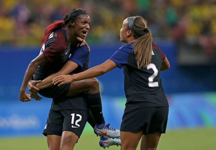 Crystal Dunn (left) and Mallory Pugh (2) celebrate Dunn's first-half goal against Colombia. Dunn and Pugh each scored their f
