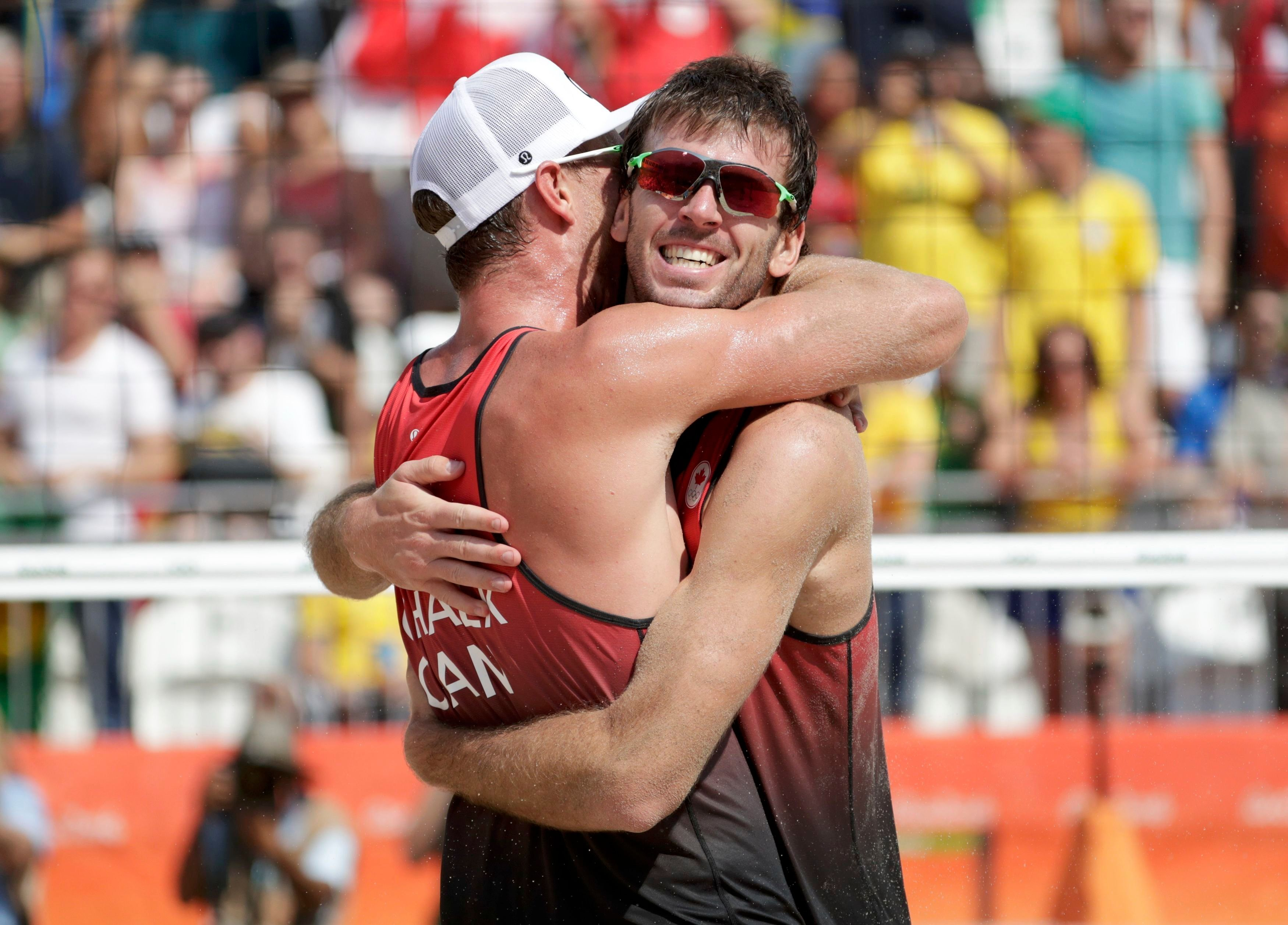 2016 Rio Olympics - Beach Volleyball - Men's Preliminary - Beach Volleyball Arena - Rio de Janeiro, Brazil - 09/08/2016. Chaim Schalk (CAN) of Canada and Ben Saxton (CAN) of Canada celebrate.   REUTERS/Ricardo Moraes   FOR EDITORIAL USE ONLY. NOT FOR SALE FOR MARKETING OR ADVERTISING CAMPAIGNS.