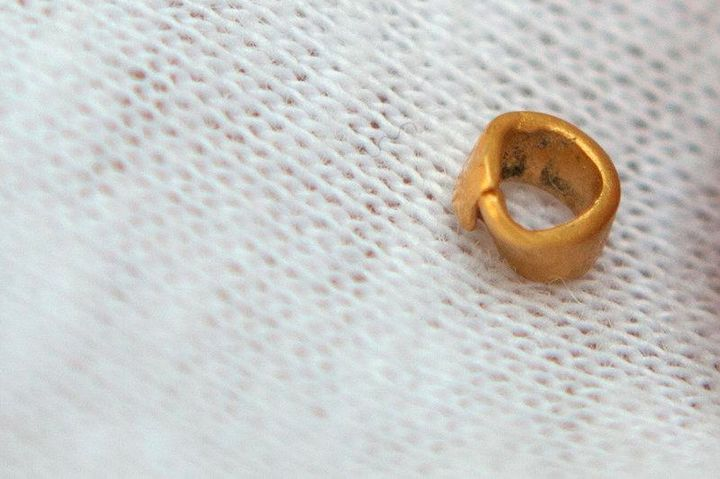 A 15-centigrams gold bead is pictured in village of Yunatsite, Bulgaria, August 8, 2016.