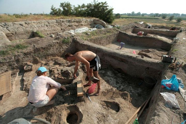 Bulgarian archaeologists dig during excavation works in an ancient settlement.