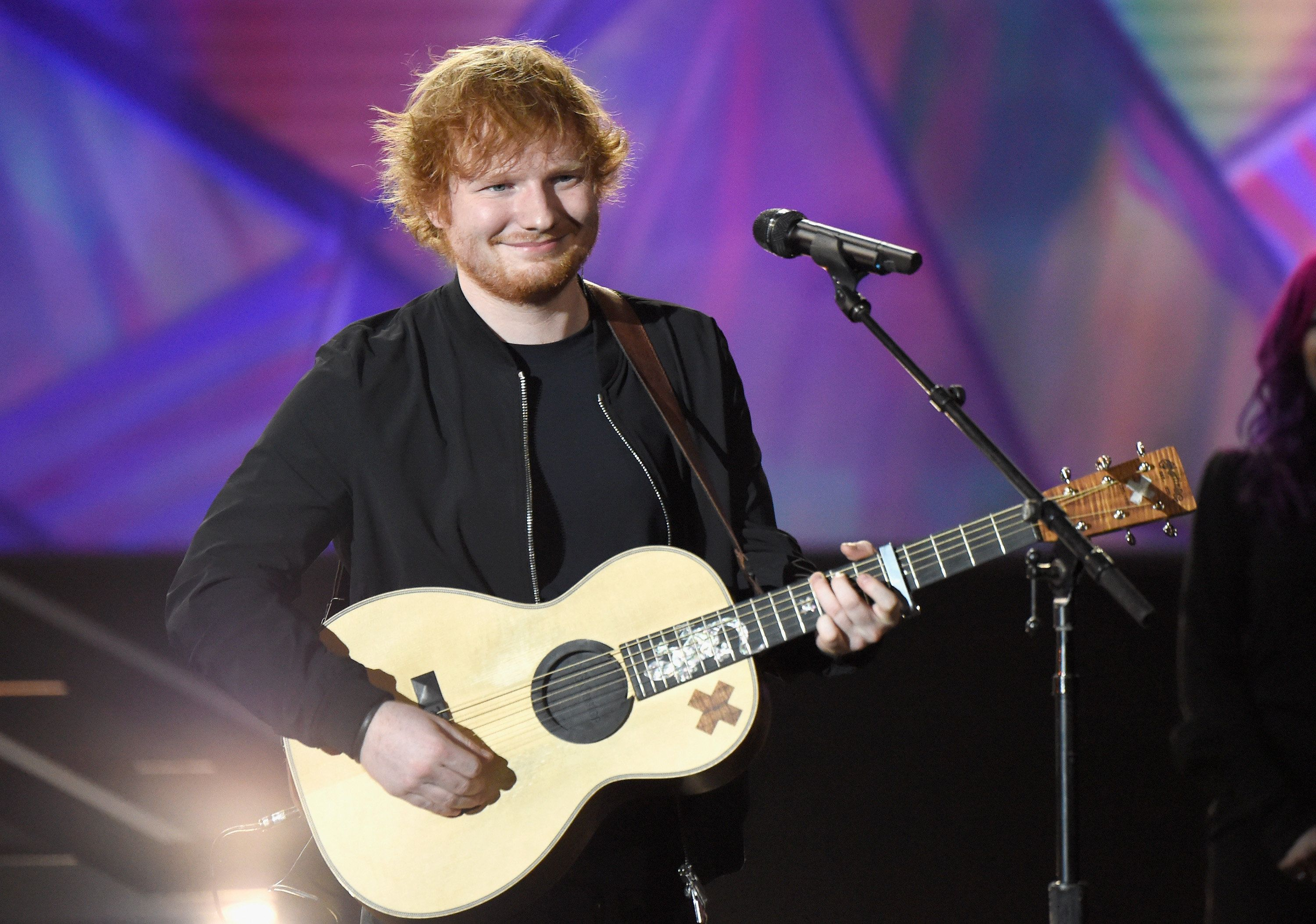 LOS ANGELES, CA - NOVEMBER 18:  Recording artist Ed Sheeran performs onstage at A+E Networks 'Shining A Light' concert at The Shrine Auditorium on November 18, 2015 in Los Angeles, California.  (Photo by Kevin Mazur/Getty Images for A+E Networks)
