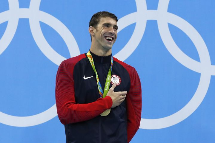 USA's Michael Phelps laughs on the podium with his gold medal at the Rio 2016 Olympic Games on Tuesday.