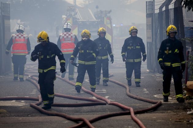 Firefighters try to extinguish the fire at London's Studio 338 nightclub in North