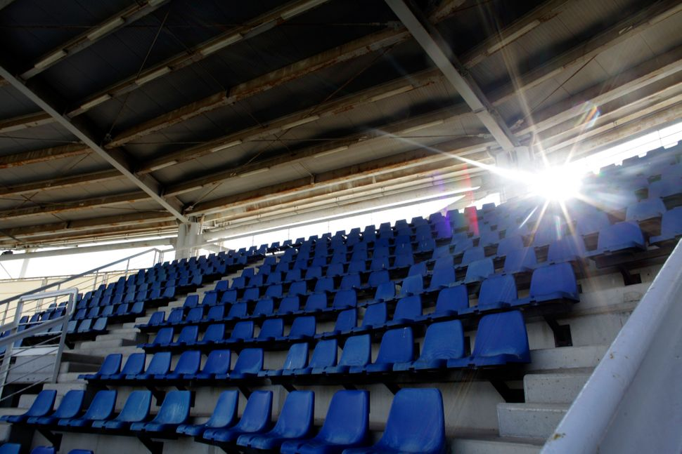 An empty stadium seating stand is seen at the abandoned Olympic baseball field at the former Athens International Airport in