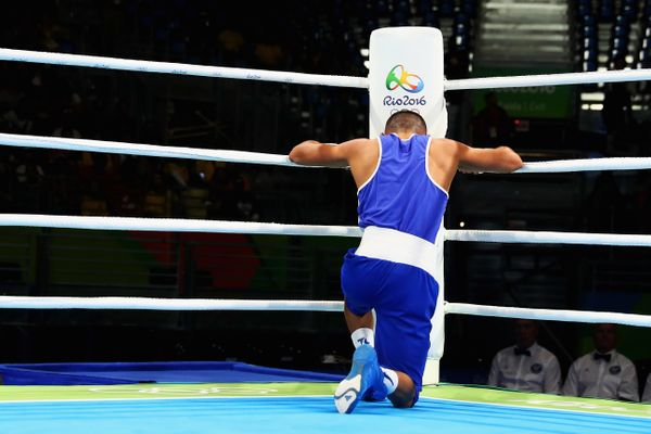 Teofimo Andres Lopez Rivera of Honduras prays after his fight with Sofiane Oumiha of France in the Men's Light 60 kg prelimin