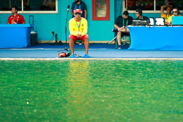 A lifeguard sits by the edge of the diving pool on Day 4 of the Rio 2016 Olympic