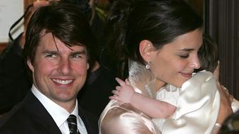 Actors Tom Cruise and Katie Holmes leave a restaurant with their daughter Suri in Rome November 16, 2006. The couple are tipped to have chosen a 15th century castle just outside of Rome as the location for their celebrity wedding. REUTERS/Max Rossi  (ITALY)